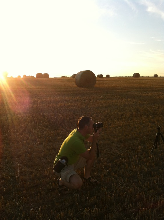 Behind the scenes shot of Thomas holm in a field
